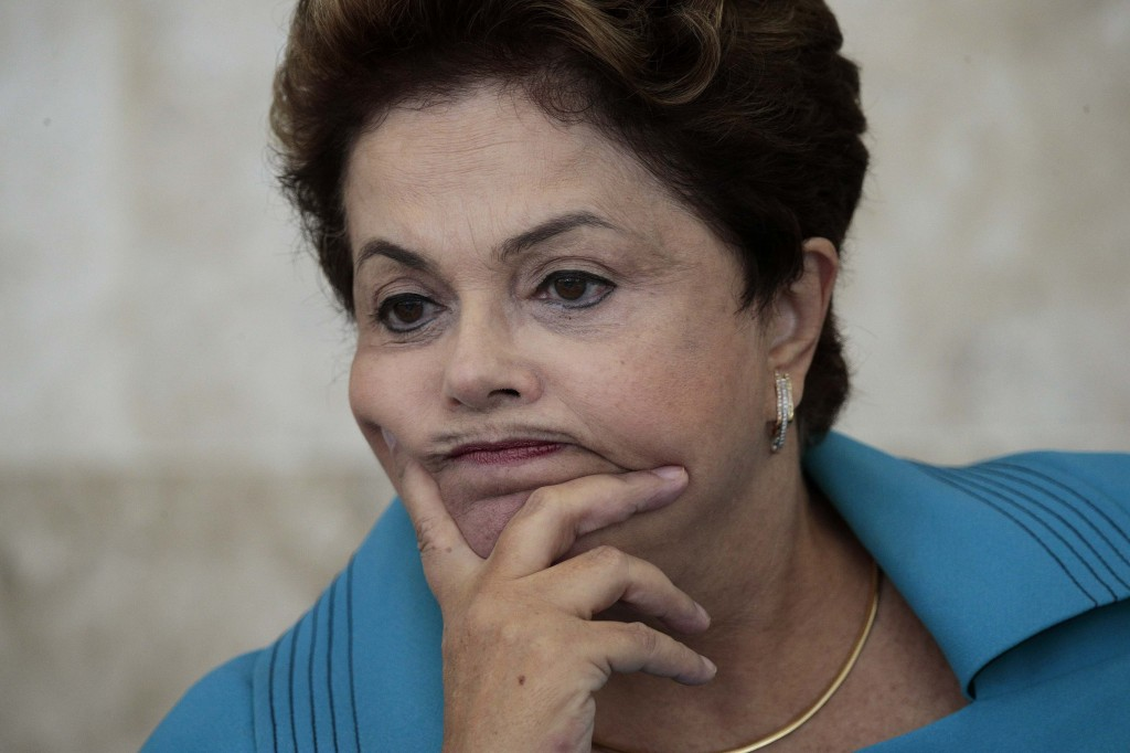 Brazil's President Dilma Rousseff reacts during a meeting of the Council for Economic and Social Development (CDES) in Brasilia