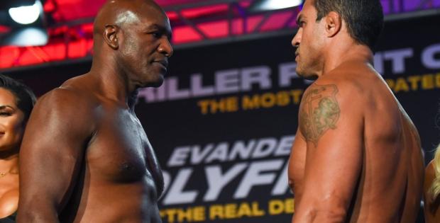 Victor Belfort x Evander Holyfield em combate neste sábado, na Flórida